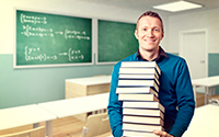teacher carrying stack of books