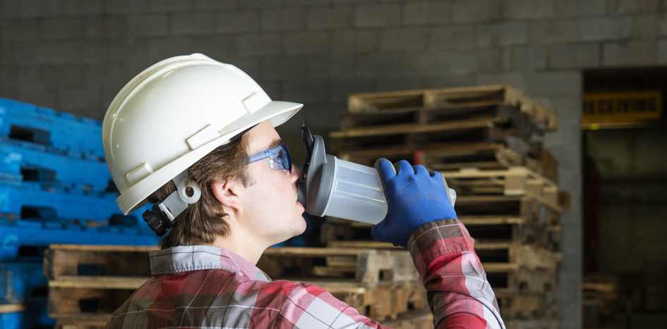 worker drinking water for summer heat safety
